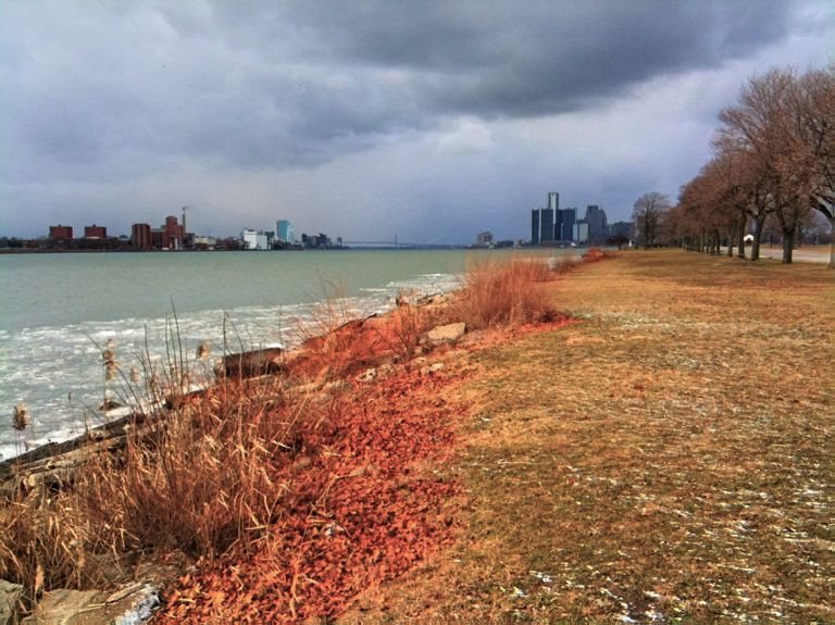 Photo of: View of downtown Detroit and Windsor over the Detroit River, from Belle Isle