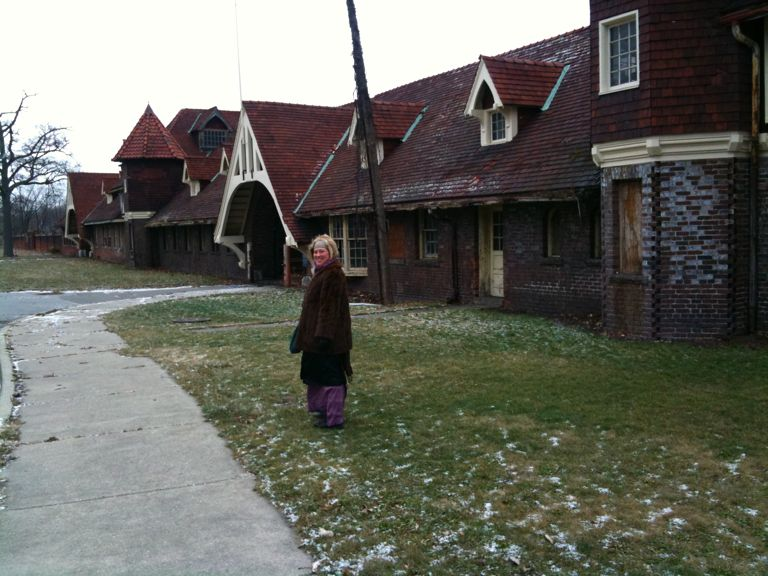 Photo of: Alexis in front of the old stables at Belle Isle